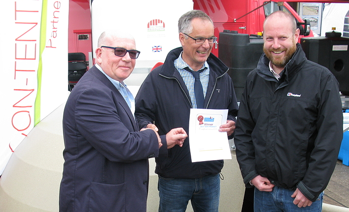 The managing director of Pig World's publisher, Lewis Business Media, John Lewis, presents the winner's certificate to Adrian Lawson of Rattlerow Farms, as Jamie Macdonald of Contented products looks on.