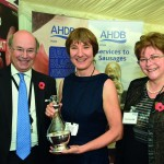 Dr Williamson, centre, receives the David Black Award from Defra Minister Lord Gardiner and former AHDB Pork chair Meryl Ward