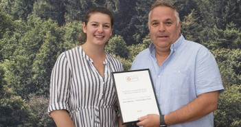 Ellie Jesson, from the Prince's Countryside Fund, presented the award to Packing-ton Pork's pig production director, John Clappison