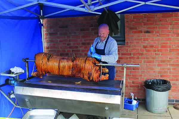 Andrew prepares a hog roast for NPA's 20th anniversary celebrations