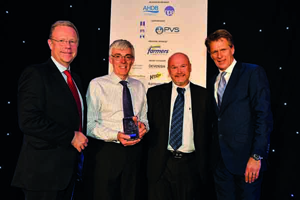 Grant Morrow and Andrew Feemantle received the Indoor Producer award from Jonathan Farnhill, ForFarmers business unit director, with host Andrew Castle, right