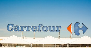 Carrefour supermarket chain brand logo at building