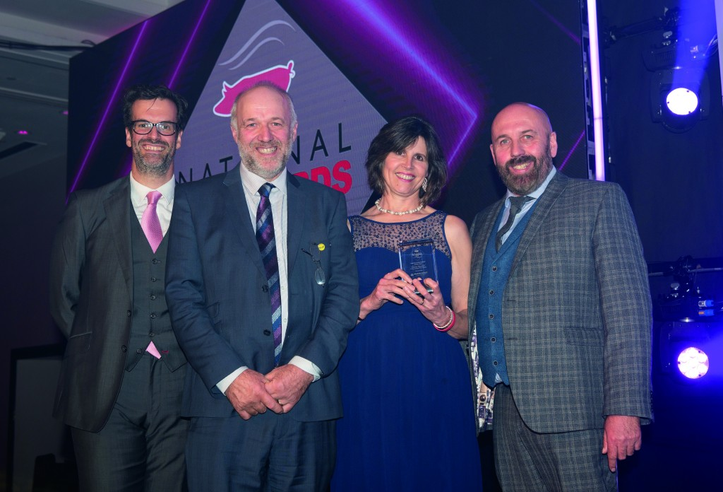 Stephen and Karen, centre, received their award from Simon Davies, Meadow Quality's commercial director, right, and host Marcus Brigstocke, left